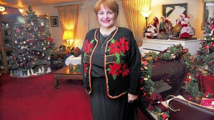 Carol Vicini, with her year-round Christmas decorations in her home in Whitehall.