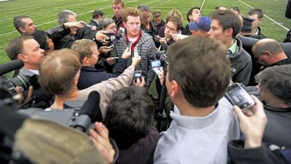 Penn State quarterback Matt McGloin speaks with reporters Monday in University Park. McGloin suffered a concussion in a scuffle Saturday with teammate Curtis Drake in the locker room and has not been medically cleared to return.