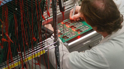 A printed circuit board is checked after assembly at Industrial Scientific Corp. The company manufactures gas detection monitors.