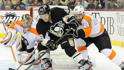 Penguins' Joe Vitale is stopped by the Flyers Marc-Andre Bourdon.