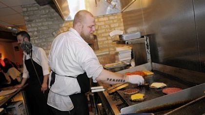 Zachary Winghart works the grill at Winghart&#039;s Burger & Whiskey Bar in Market Square.