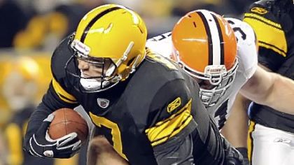 Ben Roethlisberger's left foot is twisted underneath Browns defensive lineman Scott Paxson in the second quarter Thursday. Roethlisberger left the game but returned to start the second half.