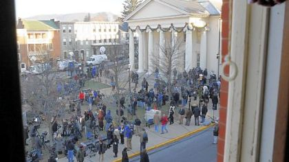 News crews linger on the lawn of the Centre County Courthouse after Jerry Sandusky waived his preliminary hearing.