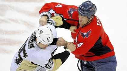 Capitals defenseman John Erskine fights with right winger Arron Asham Thursday at Verizon Center in Washington.