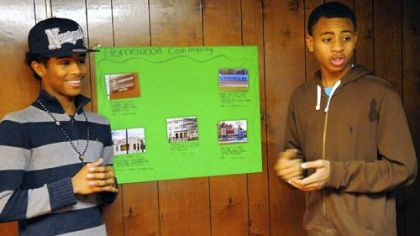 Anthony Thompson, left, 16, and Naekwon Wright, 15, present their community project for the Junior Green Corps of Operation Better Block in Homewood.