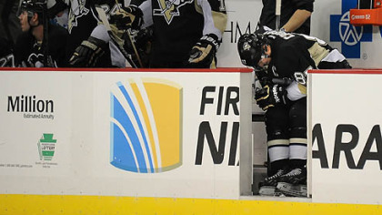 Penguins&#039; Sidney Crosby makes his way back to the bench in pain after colliding with  teammate Chris Kunitz in the third period.