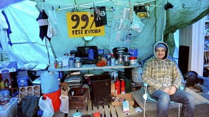 Occupy Pittsburgh protester Mike Klaiber of the South Side sits inside the kitchen tent at Mellon Green on Grant Street, Downtown, on Friday. The group plans to begin winterizing its encampment this weekend.