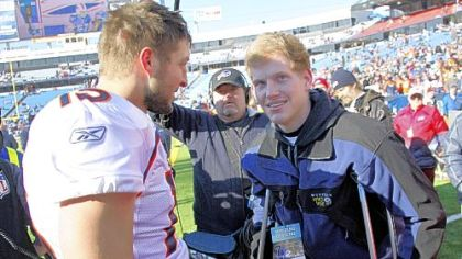 Denver Broncos quarterback Tim Tebow, left, meets with Jacob Rainey before a game against the Buffalo Bills Saturday in Orchard Park, N.Y. Rainey, a junior at Woodberry Forest School in Orange, Va., had a portion of his right leg removed after sustaining a severe knee injury Sept. 3 in a football scrimmage.