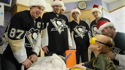 Camden Lookabaugh, 3, smiles at members of the Pittsburgh Penguins team after Sidney Crosby put toy safety goggles on him. Camden is a patient at Children's Hopsital of Pittsburgh of UPMC and received a toy tool box from the Penguins, who were visiting the hospital.  Along with Crosby is Zbynek Michalek, Evgeni Malkin, Marc-Andre Fleury, Brooks Orpik and Steve MacIntyre.