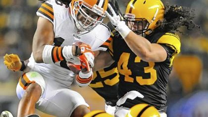 Troy Polamalu stops Browns Joshua Cribbs for no gain Thursday at Heinz Field.
