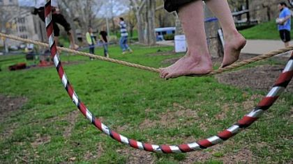 Slacklining is a balance activity similar to tightrope walking, but on a line that is loosely strung rather than tight.