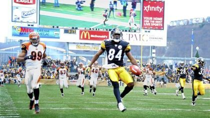 Antonio Brown celebrates in the end zone after scoring on a 60-yard punt return against the Bengals in the second quarter Sunday at Heinz Field.