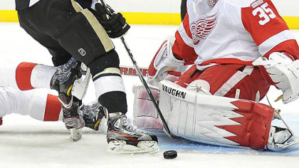 Chris Kunitz is stopped by the Red Wings' Jimmy Howard in the first period at Consol Energy Center.