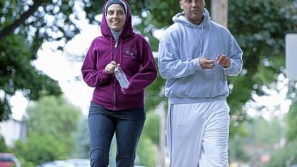 "Nawal Aoude, a pediatric respiratory therapist, and her husband Nader go for a walk in a scene from the TLC series, ""All-American Muslim."""