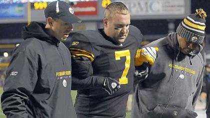 Steelers quarterback Ben Roethlisberger is helped off the field after being injured against Cleveland Dec. 8.