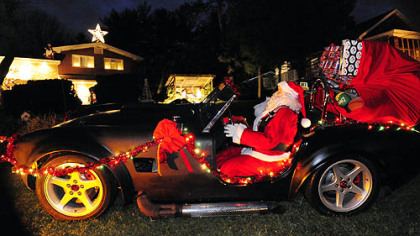 Santa rides in in a 1965 Shelby Cobra kit car made by Carol Vincini's son, Mike Palmer, an artist and mechanical engineer.