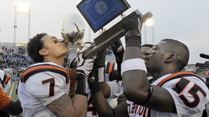 Clairton's Dakota Halcomb kisses the trophy after defeating Southern Columbia.
