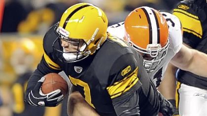 Ben Roethlisberger is sacked by the Browns' Scott Paxson in the second quarter Thursday night. Roethlisberger left the field with an injury on the play.