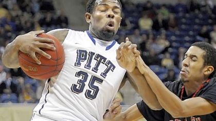 Pitt's Nasir Robinson grabs a rebound against Saint Francis' Kameron Ritter in the first half Tuesday night at Petersen Events Center.
