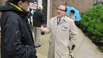 Marty Childs of Squirrel Hill listens to Councilman Doug Shields as he campaigns at the Colfax Elementary School.