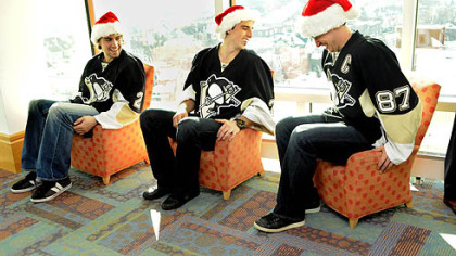 Penguins captain Sidney Crosby pulls himself out of a child-sized chair while he, Matt Niskanen and Marc-Andre Fleury wait to visit patients at Children's Hopsital of Pittsburgh of UPMC in Lawrenceville.