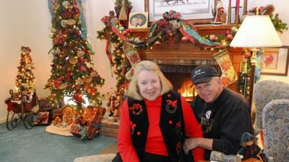 Bill and Celine Wilson have set up 11 Christmas trees at their Upper St. Clair house.