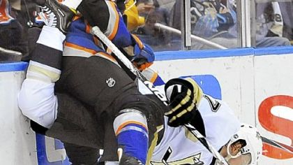 Paul Martin and New York&#039;s Tim Wallace get tangled along the boards Saturday night in the Penguins&#039; 6-3 victory against the Islanders in Uniondale, N.Y.