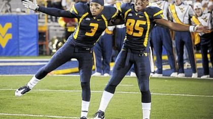 Stedman Bailey, left, Willie Milhouse and West Virginia are headed to the Orange Bowl as the Big East&#039;s BCS bid.