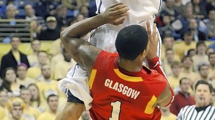 John Johnson drives to the basket against VMI's Rodney Glasgow in the first half of Pitt's blowout win Tuesday night at Petersen Events Center. Johnson came off the bench to score 13 points.