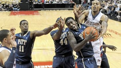 Ashton Gibbs drives on Duquesne's Andre Marhold for two of his team-high 18 points for Pitt.