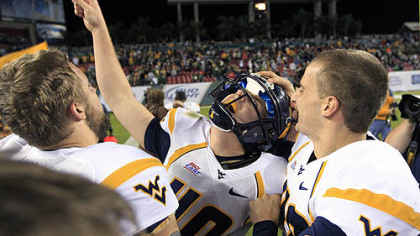 West Virginia's Tyler Bitancurt (40) celebrates with teammates after kicking the game-winning field goal in West Virginia's 30-27 win over South Florida last night in Tampa.