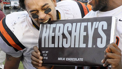 Clairton's Dakota Halcomb bites a large Hershey's bar after defeating Southern Columbia at Hersheypark Stadium.