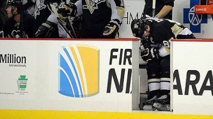 Penguins captain Sidney Crosby sits in pain on the bench in a game last week against Boston.