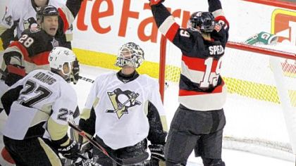 Penguins goaltender Brent Johnson looks up as the Senators&#039; Jason Spezza (19) and Zenon Knopka (28) celebrate Knopka&#039;s goal in the second-period Friday in Ottawa, Ontario.