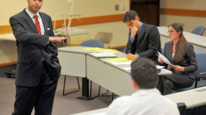 Ken Hager questions a seated John Legarreta during a mock trial in his advanced trial advocacy class at the University of Pittsburgh&#039;s School of Law.