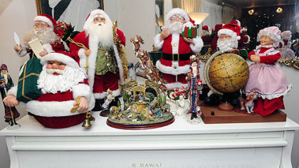 Santa Clause figures in Carol Vicini's home.