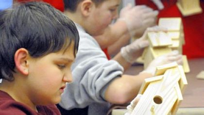 Patrick Worrall, 12, works on his birdhouse.