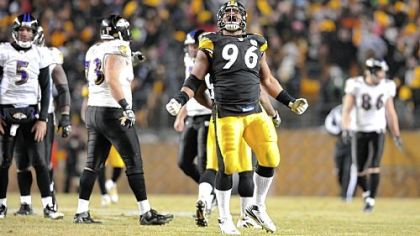 Ziggy Hood celebrates after sacking Baltimore quarterback Joe Flacco during last season's AFC Divsional playoff game.