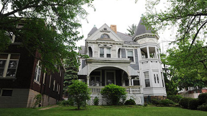 This Queen Anne-style home at 1425 Brownsville Road in Carrick is on the market for $109,900. The apartment building on the left sold in 2008 for $125,000.