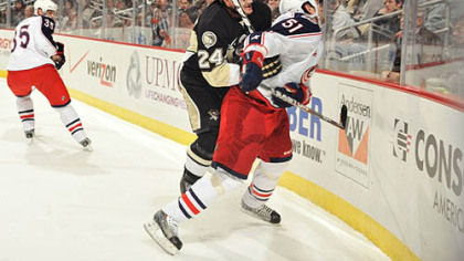 Penguins forward Mtt Cooke checks Blue Jackets defenseman Fedor Tyutin the first period of Tuesday's game at CONSOL Energy Center. Cooke was assessed a five-minute major penalty for charging on the play.