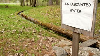 Members of the Sykesville Hunting Club in Clearfield County posted this sign near the natural spring on their hunting camp property in Moshannon State Forest. The spring was contaminated by leaks from Marcellus Shale drilling operations.