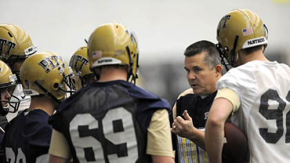 New Pitt head coach Todd Graham talks with a group of players during the first day of spring practice at the UPMC Sports Performance Complex on the South Side.