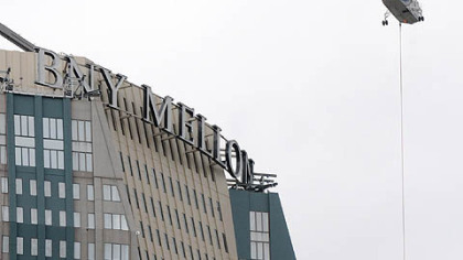 The BNY Mellon sign goes up last October.