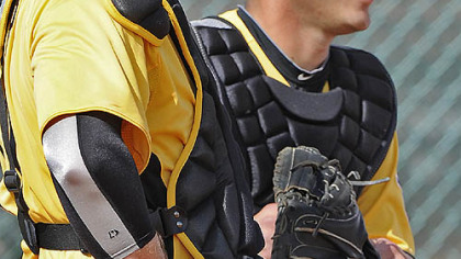Catchers Chris Snyder, left, and Tony Sanchez look on at spring training in February in Bradenton, Fla.