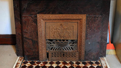 An upper-floor fireplace.