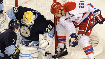 The Penguins' Marc-Andre Fleury stops a shot by the Capitals' Mike Knuble in the first period at the Winter Classic at Heinz Field last night.