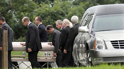 A casket is taken into Murrysville Community Church for the funeral for Kimberly, Brenna and Mikaela Griffith, who died in Friday's flash flood along Washington Boulevard.