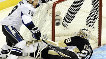Penguins goaltender Marc-Andre Fleury makes a save on Lightning center Dominic Moore in the first period Wednesday at Consol Energy Center.