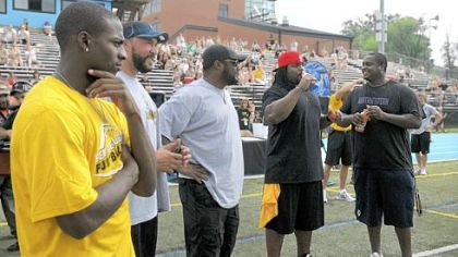 Emmanuel Sanders, Charlie Batch, coach Mike Tomlin, Willie Colon and Tria Essex were on hand at Ben Roethlisberger's youth football camp Monday at Seneca Valley.
