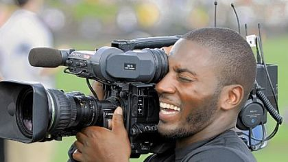 The Steelers' Ryan Clark takes his turn behind the camera during training camp Wednesday.